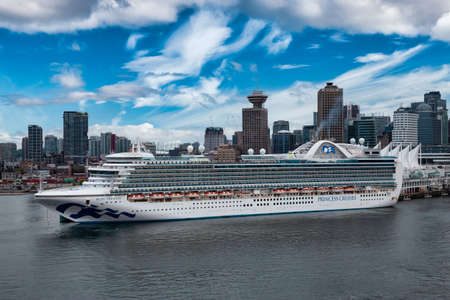 Vancouver, British Columbia, Canada - September, 2019: Big White Cruise Ship Parked at Canada Place in Coal Harbour with Downtown City in Background.