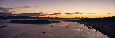 Aerial Panoramic View of Fraser River. Dramatic Colorful Sunrise Sky. Taken over Port Mann Bridge in Surrey, Vancouver, British Columbia, Canada. 版權商用圖片