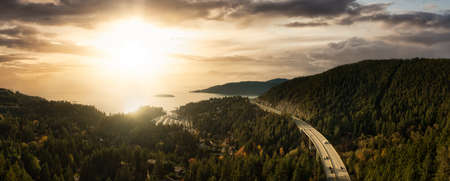 Horseshoe Bay, West Vancouver, British Columbia, Canada. Aerial view of residential homes near the Highway during a bright and sunny sunset in Fall Season.