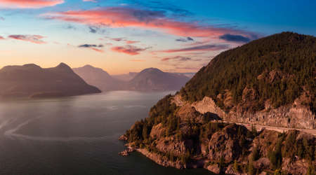 Sea to Sky Hwy in Howe Sound near Horseshoe Bay, West Vancouver, British Columbia, Canada. Aerial panoramic view. Dramatic Colorful Sunset Sky.