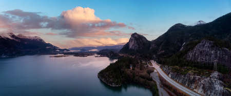 Aerial Panoramic view of Sea to Sky Highway with Chief Mountain in the background. Colorful Twilight Sky Art Render. Taken near Squamish, North of Vancouver, British Columbia, Canada.