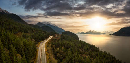 Sea to Sky Hwy in Howe Sound near Squamish, British Columbia, Canada. Aerial panoramic View. Dramatic Colorful Sunset Sky Art Render. 版權商用圖片