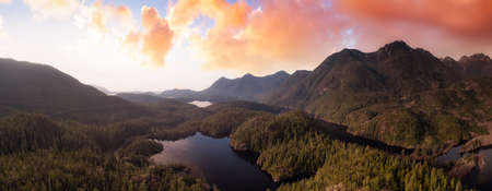Beautiful Aerial Panoramic View of Larry Lake. Colorful Sunset Sky. Located on the West Coast of Vancouver Island near Tofino and Ucluelet, British Columbia, Canada.