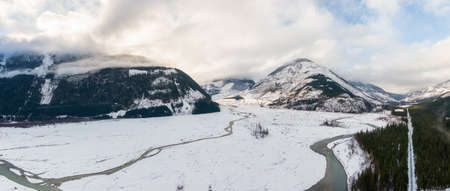 Aerial Panoramic View of Beautiful Canadian Nature Landscape. Snow Covered in Winter. Located near Pemberton, British Columbia, Canada. Background Panorama