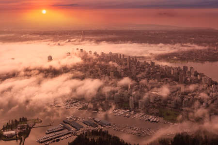 Downtown Vancouver, British Columbia, Canada. Aerial View of the Modern Urban City, Stanley Park, Harbour and Port. Viewed from Airplane Above. Colorful Sunrise Artistic Render