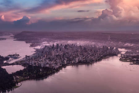 Downtown Vancouver, British Columbia, Canada. Aerial View of the Modern Urban City, Stanley Park, Harbour and Port. Viewed from Airplane Above. Colorful Sunset Artistic Render