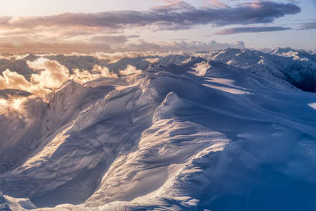 Aerial landscape view of the snow covered mountain range North of Vancouver, British Columbia, Canada. Artistic Dark Render 版權商用圖片