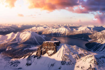 Beautiful landscape view of snow covered mountain with a colorful sunset sky. 版權商用圖片