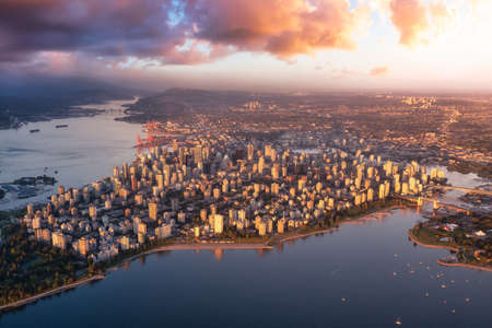 Aerial view of a modern city on the Pacific West Coast. Downtown Vancouver, BC, Canada. Dramatic Colorful Sunset Sky Art Render.