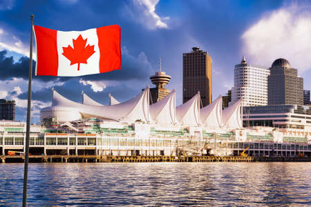 Canada Place and commercial buildings in Downtown Vancouver. Canadian National Flag Composite. British Columbia, Canada. Dramatic Sunset Sky 版權商用圖片