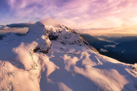 Beautiful aerial landscape view on the rocky mountains during a cloudy sunset. Mnt Garibaldi. Taken near Whistler and Squamish, British Columbia, Canada.
