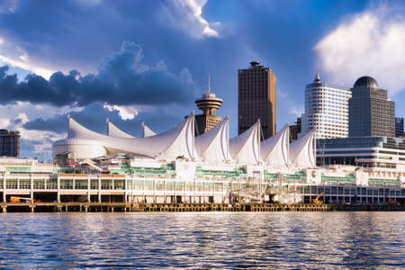 Canada Place and commercial buildings in Downtown Vancouver Viewed from water. Modern Architecture in Urban City on West Coast of British Columbia, Canada. Sunset Sky Art Render