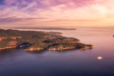 Horseshoe Bay, West Vancouver, British Columbia, Canada. Aerial view of Ferry Terminal and Marina. Sunny and colorful Sunset Sky Art Render.
