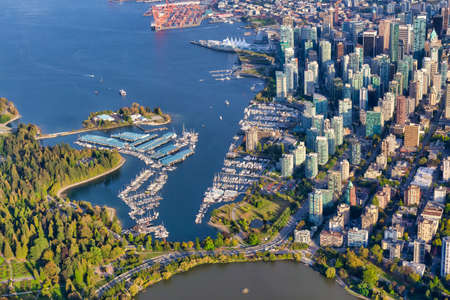 Aerial view of Coal Harbour and a modern Downtown City during a vibrant sunny morning. Taken in Vancouver, British Columbia, Canada.