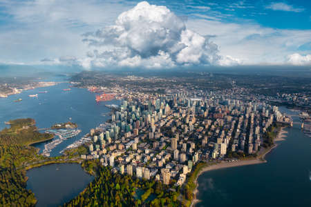 Aerial view of Stanley Park and Downtown Vancouver, BC, Canada. Modern City on the Pacific West Coast. Dramatic Colorful Sky Art Render.