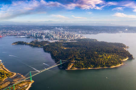 Beautiful Aerial View of Lions Gate Bridge, Stanley Park and Vancouver Downtown, British Columbia, Canada. Colorful Sunrise Artistic Render