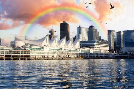 Canada Place and commercial buildings in Downtown Vancouver Viewed from water. Modern Architecture in Urban City on West Coast of British Columbia, Canada. Sunset Sky Art Render with Rainbow 版權商用圖片