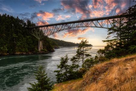 Iconic Bridge, Deception Pass, on the West Pacific Ocean Coast. Washington, United States. Colorful Sunset Sky Art Render.