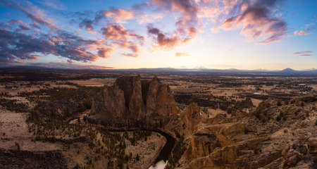 Beautiful American Mountain Landscape. Dramatic and Colorful Sunset Sky Art Render. Taken in Smith Rock, Redmond, Oregon, North America. Nature Background Panorama