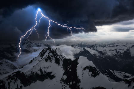 Dark Dramatic Mountain Landscape with Stormy Cloud. Thunder and Lightning Sky Artistic Render. Aerial Landscape from British Columbia, Canada.
