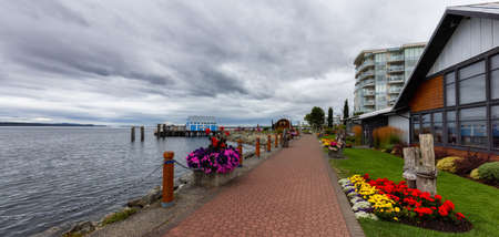 Sidney, Victoria, Vancouver Island, British Columbia, Canada - August 16, 2021: Scenic View of The Pier on the Pacific Ocean Coast during a cloudy summer day. Editorial