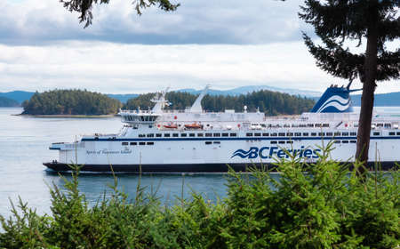 Victoria, Vancouver Island, British Columbia, Canada - August 9, 2021: BC Ferries Boat Leaving to the Terminal in Swartz Bay during sunny summer day. Editorial