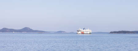 Salt Spring Island, British Columbia, Canada - August 23, 2021: BC Ferries passing by Gulf Islands during a sunny summer day.