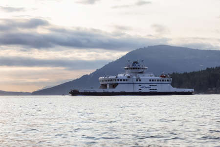 Victoria, Vancouver Island, British Columbia, Canada - August 20, 2021: BC Ferries Boat leaving the Terminal in Swartz Bay during sunny summer sunset. Editorial