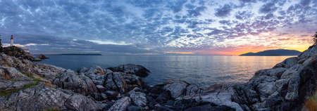 Panoramic view of a Lighthouse Park on a rocky coast during a dramatic cloudy sunset. Horseshoe Bay, West Vancouver, British Columbia, Canada. Nature Background
