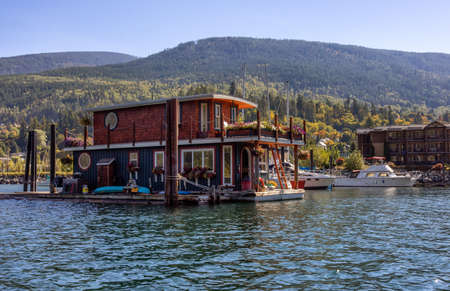 Nelson, British Columbia, Canada - September 25, 2021: Houseboat in a marina during a sunny morning. Editorial