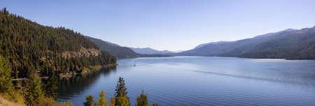 Panoramic View of Christina Lake during a sunny fall season day. West Kootenay, British Columbia, Canada. Standard-Bild