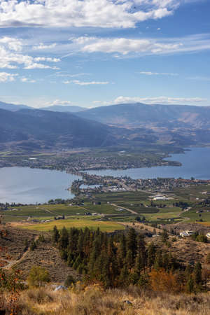 View of a Small Touristic Town during a beautiful sunny Fall season day. Taken in Osoyoos, British Columbia, Canada.
