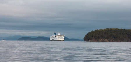 Victoria, Vancouver Island, British Columbia, Canada - August 20, 2021: BC Ferries Boat Arriving to the Terminal in Swartz Bay during sunny summer evening.