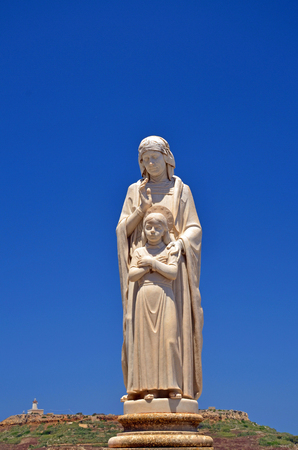 statue a women with child of religion in malta