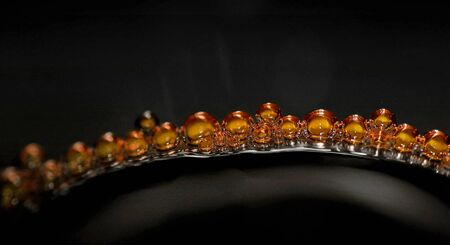 updated: bubble in orange on black background macro photo