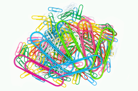 notepaper: many paperclips colorful on a white background Stock Photo