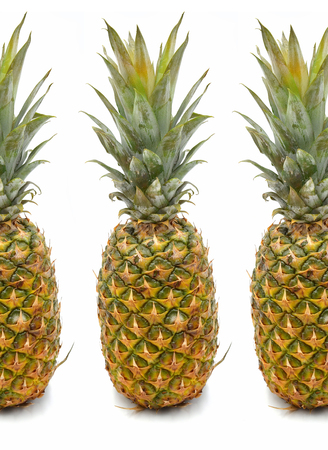 Pineapple on white background photo three times