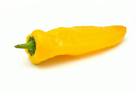 pointed paprika yellow on white background photo