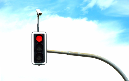 red traffic light: Traffic light with clouds in the background Stock Photo