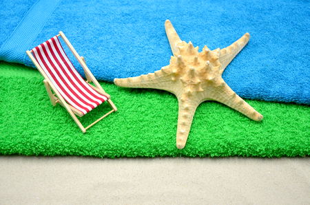 deck chair with green towel and starfish close up photo Stock Photo