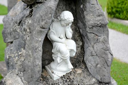 white religion statue in a close up photo