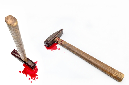 hammer with blood on white background close up