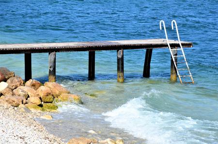 jetty pier on a lonley place lake garda italy Stock Photo