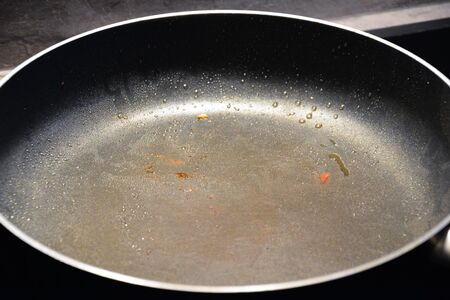 black metallic background: black pan after cooking close up photo Stock Photo