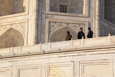 love dome: Three indian men inside the Taj Mahal in Agra, Uttar Pradseh, India