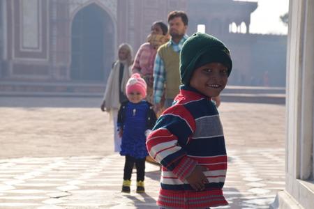 uttar pradesh: Indian kid with hat smiling in front of the room inside the Taj Mahal, Agra, Uttar Pradesh, India Editorial