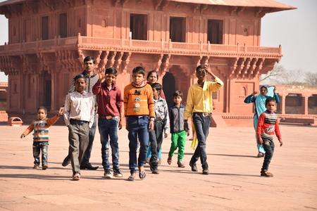 uttar pradesh: Group of indian kids walking inside Fatehpur Sikri archaeological site, Uttar Pradesh, India