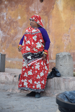 amber fort: Indian woman outside Amber Fort in Jaipur, Rajasthan, India