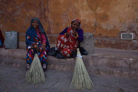 amber fort: Indian women with broom outside Amber Fort in Jaipur, Rajasthan, India Editorial