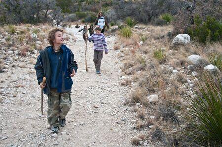 adventurous boy enjoys a family hike photo